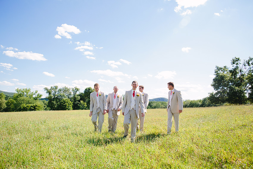 groomsmen walking at Red Barn at Hampshire College