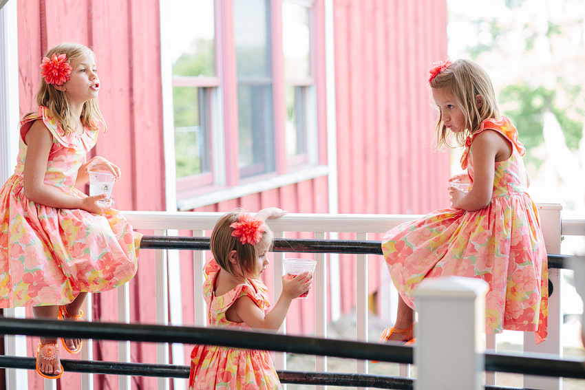 flower girls dressed in all coral and yellow