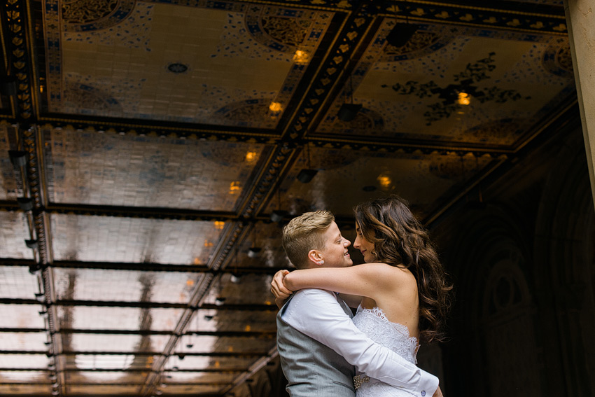 gay couple dancing underneath central park arch