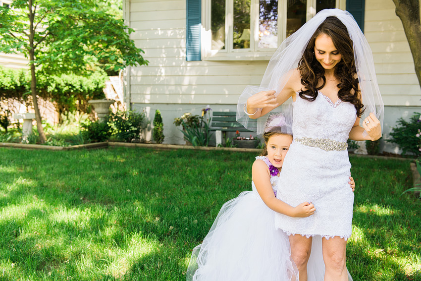 bride in short wedding dress with daughter