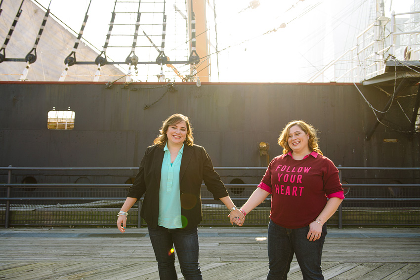 lesbians holding hands in front of ship downtown NYC
