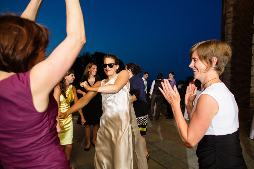bride and guests dancing during summer wedding at crane estate