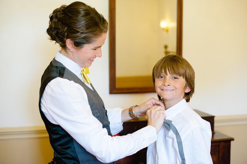 bride tieing tie