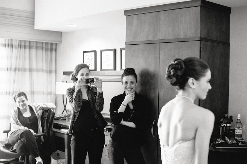 bride getting ready with family