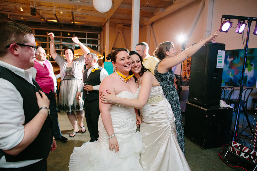 two brides embracing on dance floor