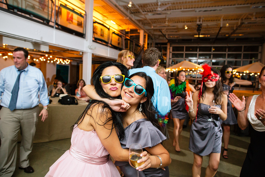 wedding guests posing in silly glasses