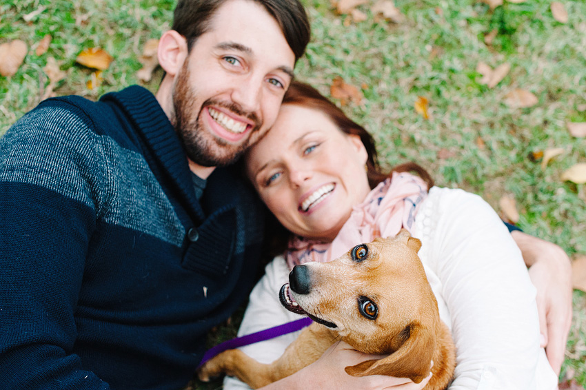 DC couple lying on ground with dog for save the dates