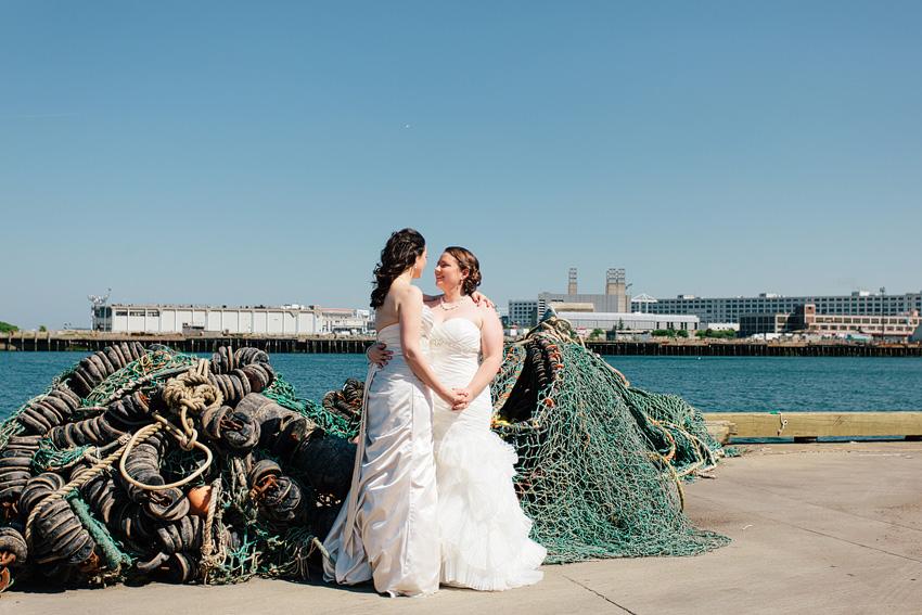 brides embracing on dock