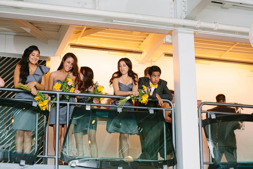 bridesmaids standing in loft area