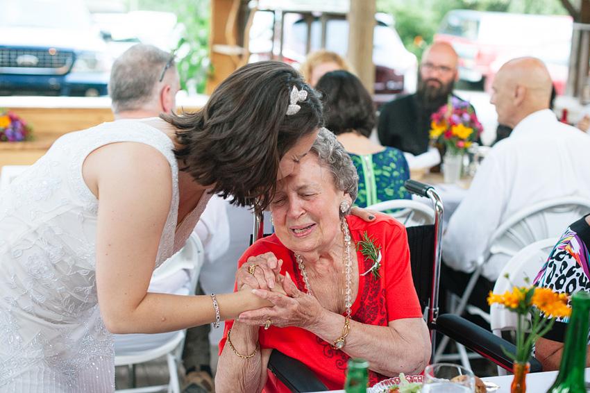 bride embracing grandmother