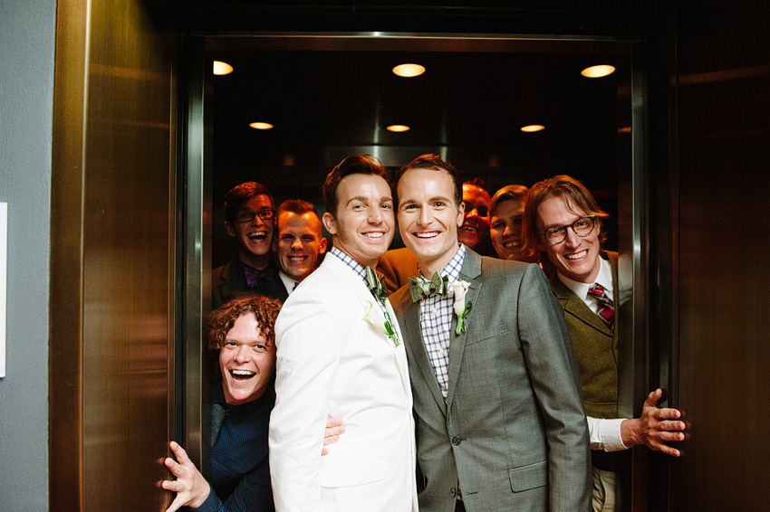 grooms with guests in elevator