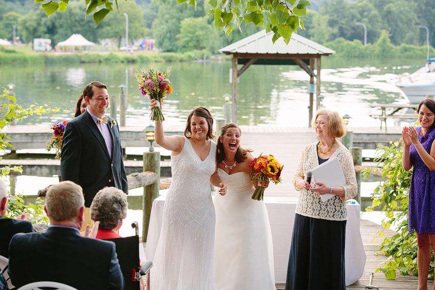 brides celebrating marriage on steamboat landing