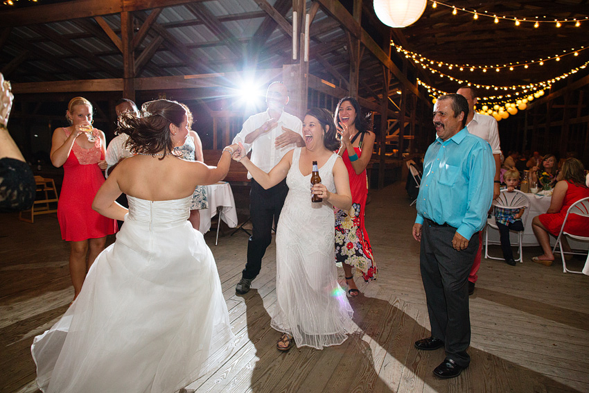 two brides dancing at wedding reception