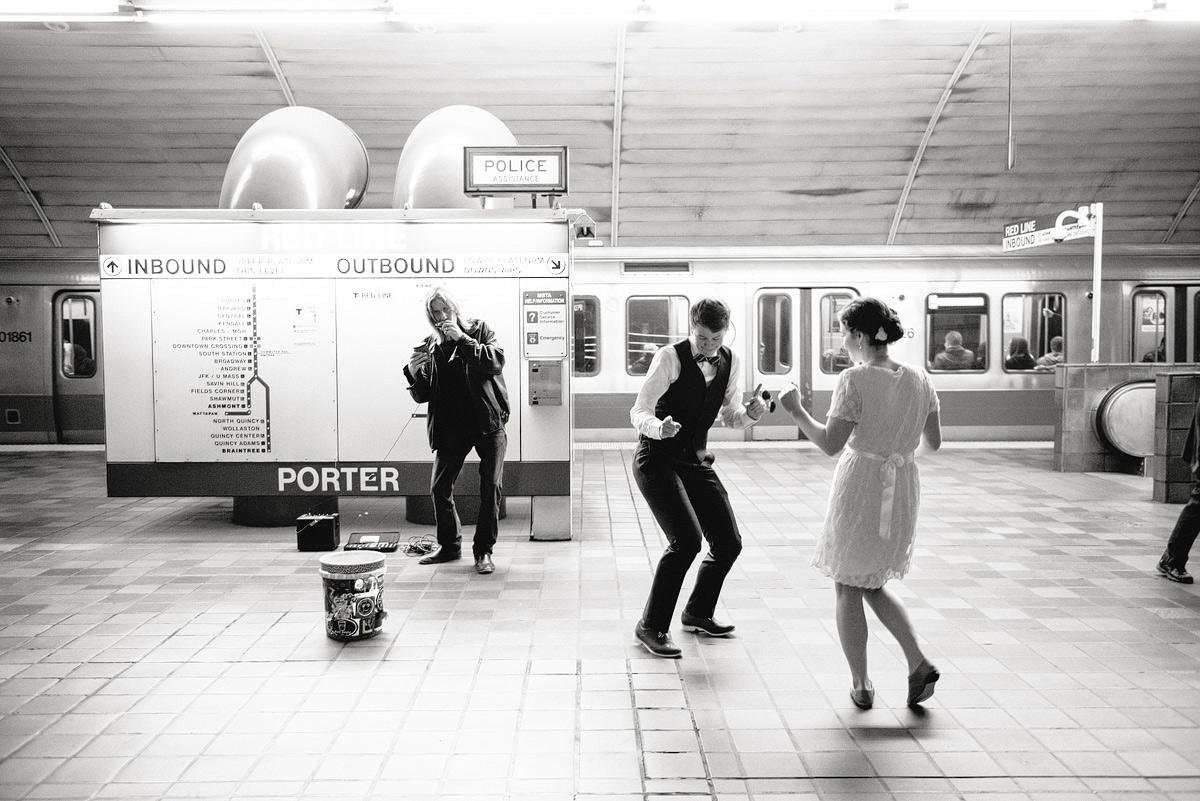 lesbian couple dances at train station