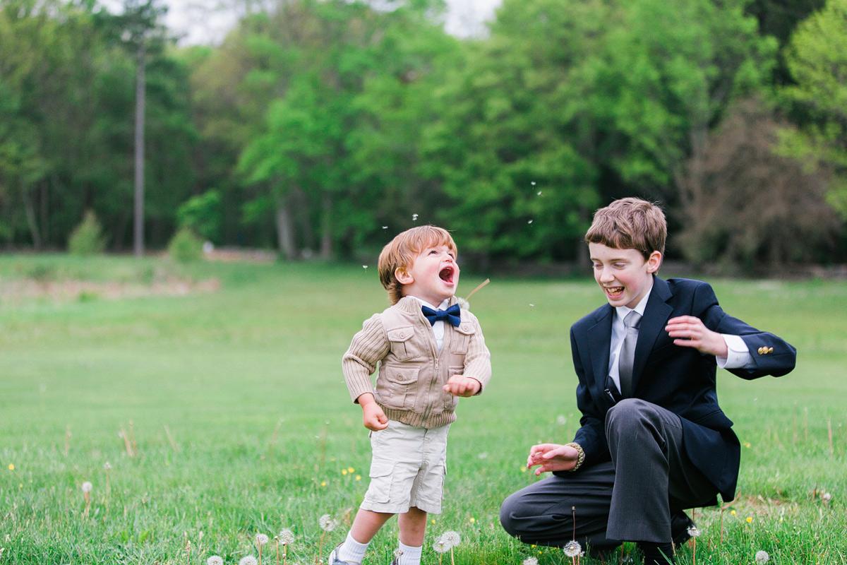 little boy laughing at codman estate wedding reception