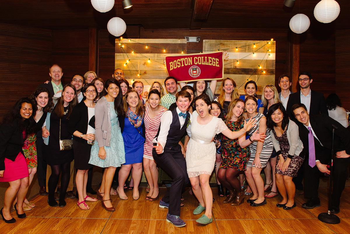 boston college alumni wedding party takes fun group shot