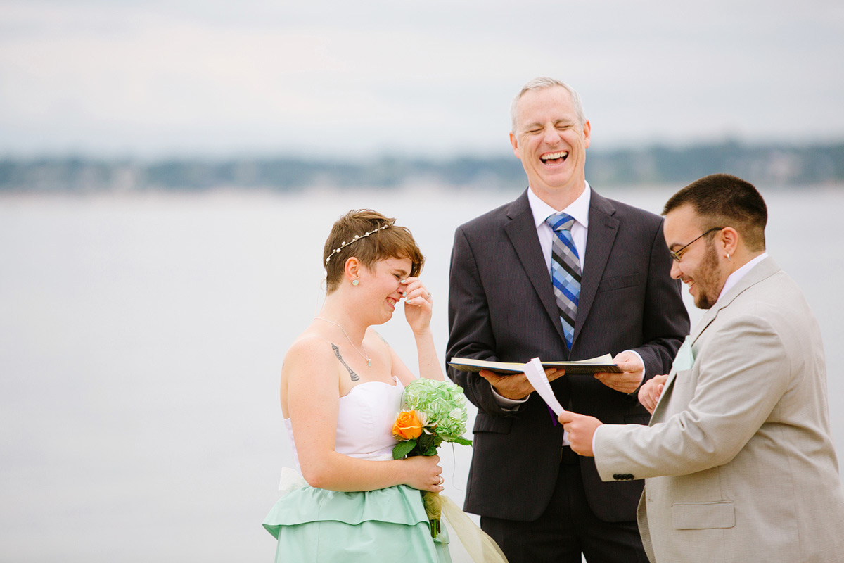 bride laughs during ceremony
