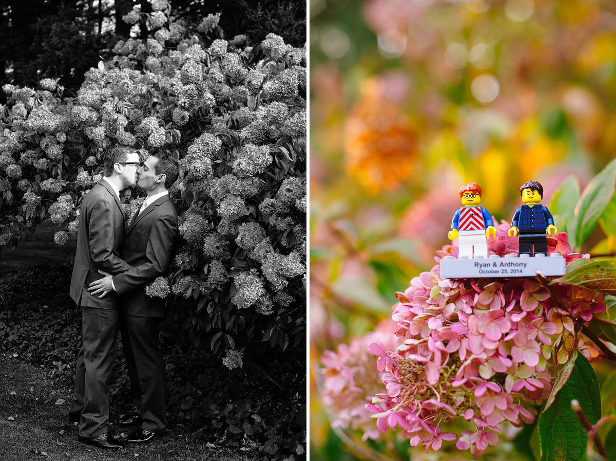 grooms kiss in front of flower bush