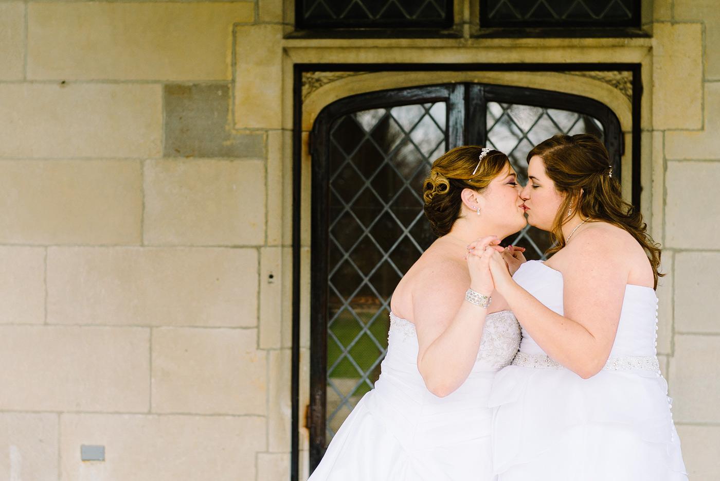 two brides kissing at long island wedding