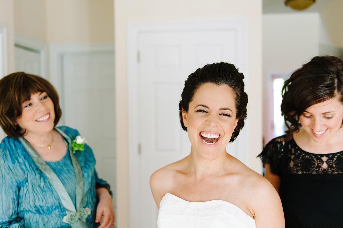 bride laughing during getting ready