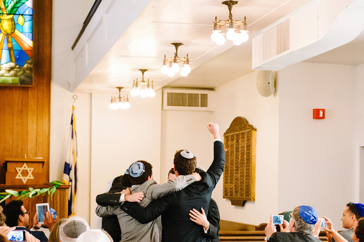 groomsmen gather for yichud