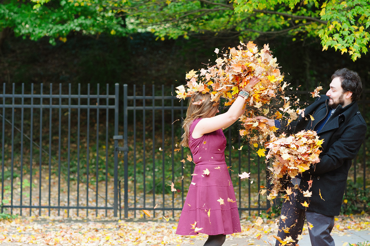woman throws leaves at man