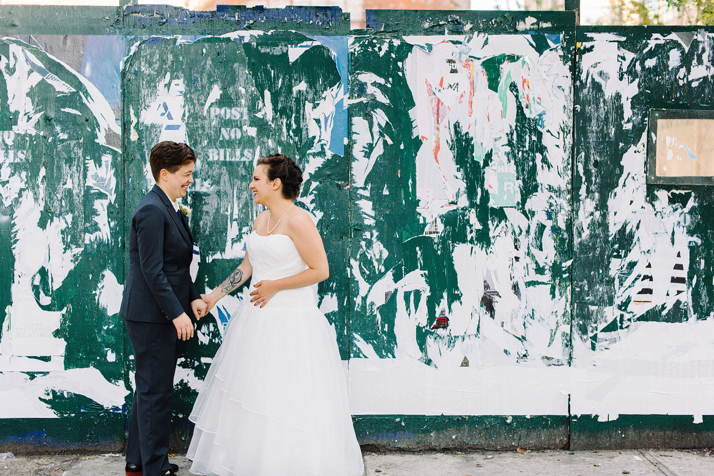 two brides with graffiti on wedding day