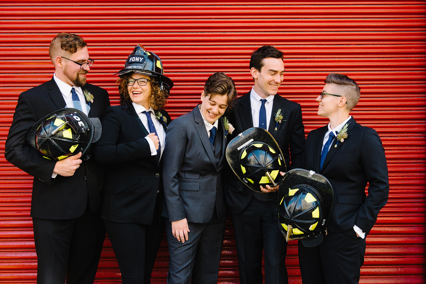 bride and bridesmaid wear firefighter helmets