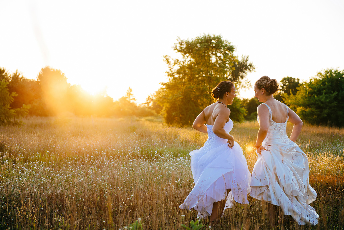 brides dancing in sunset light