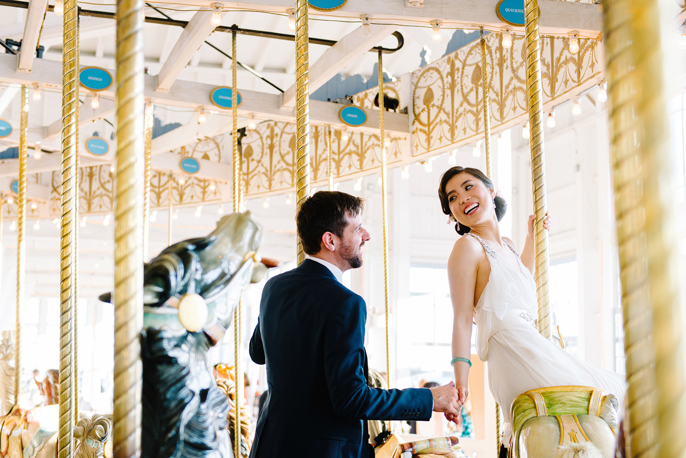 bride and groom riding carousel in new haven