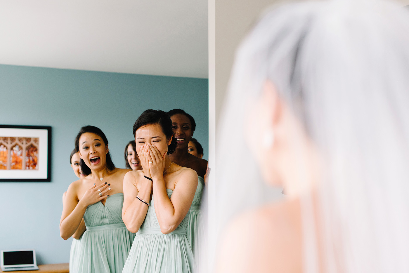 bridesmaids seeing bride at the study