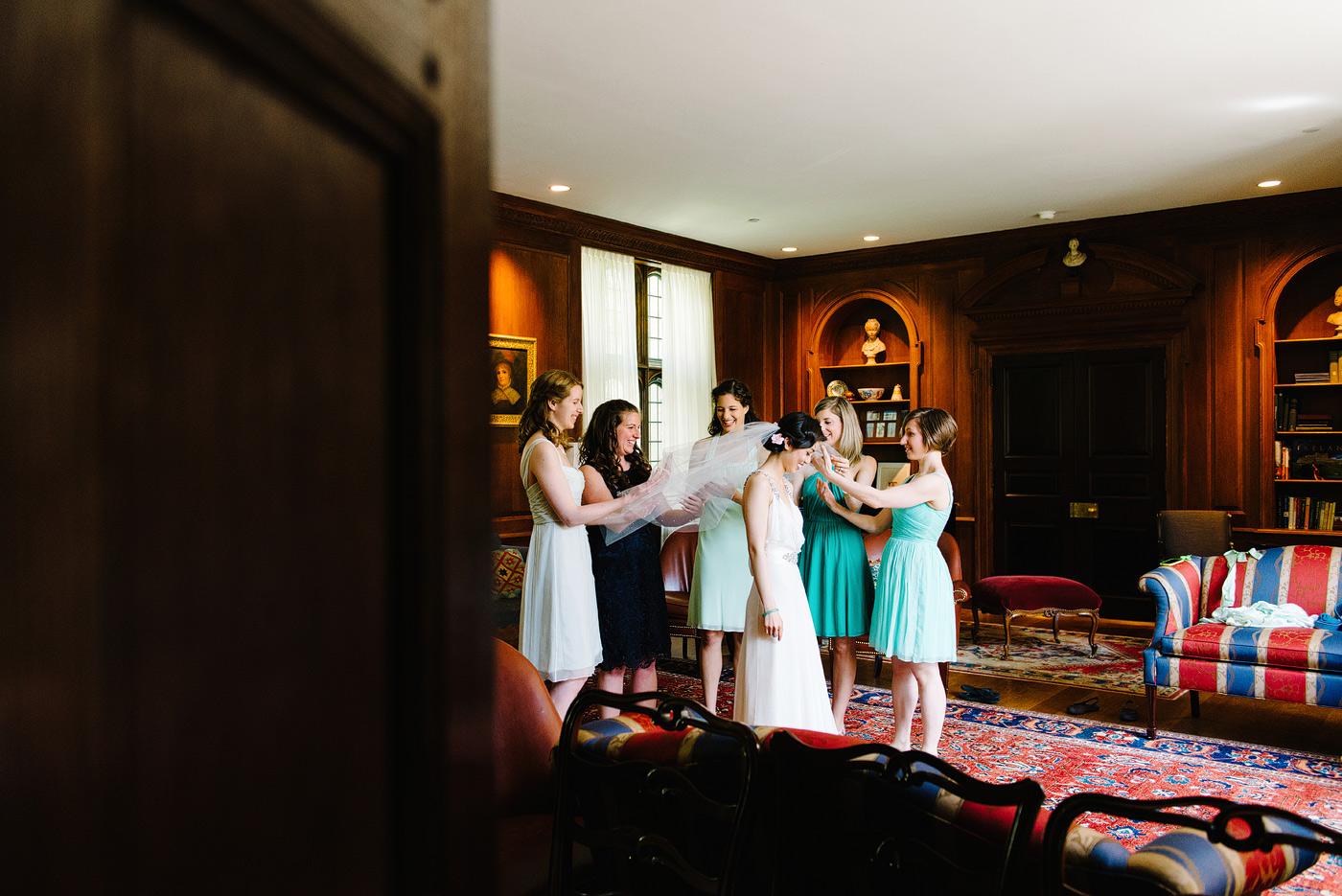 bridesmaids helping bride get ready in calhoun collge