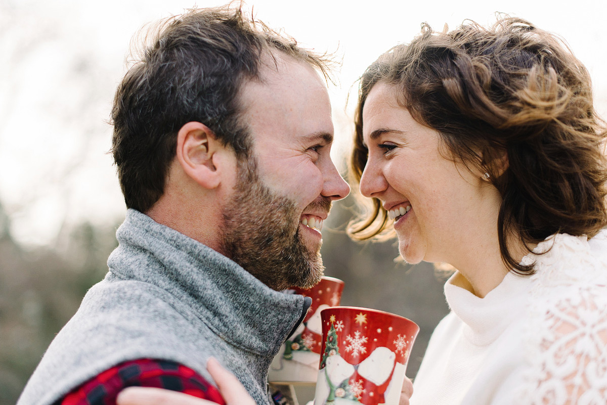 couple kissing outdoors in winter engagement