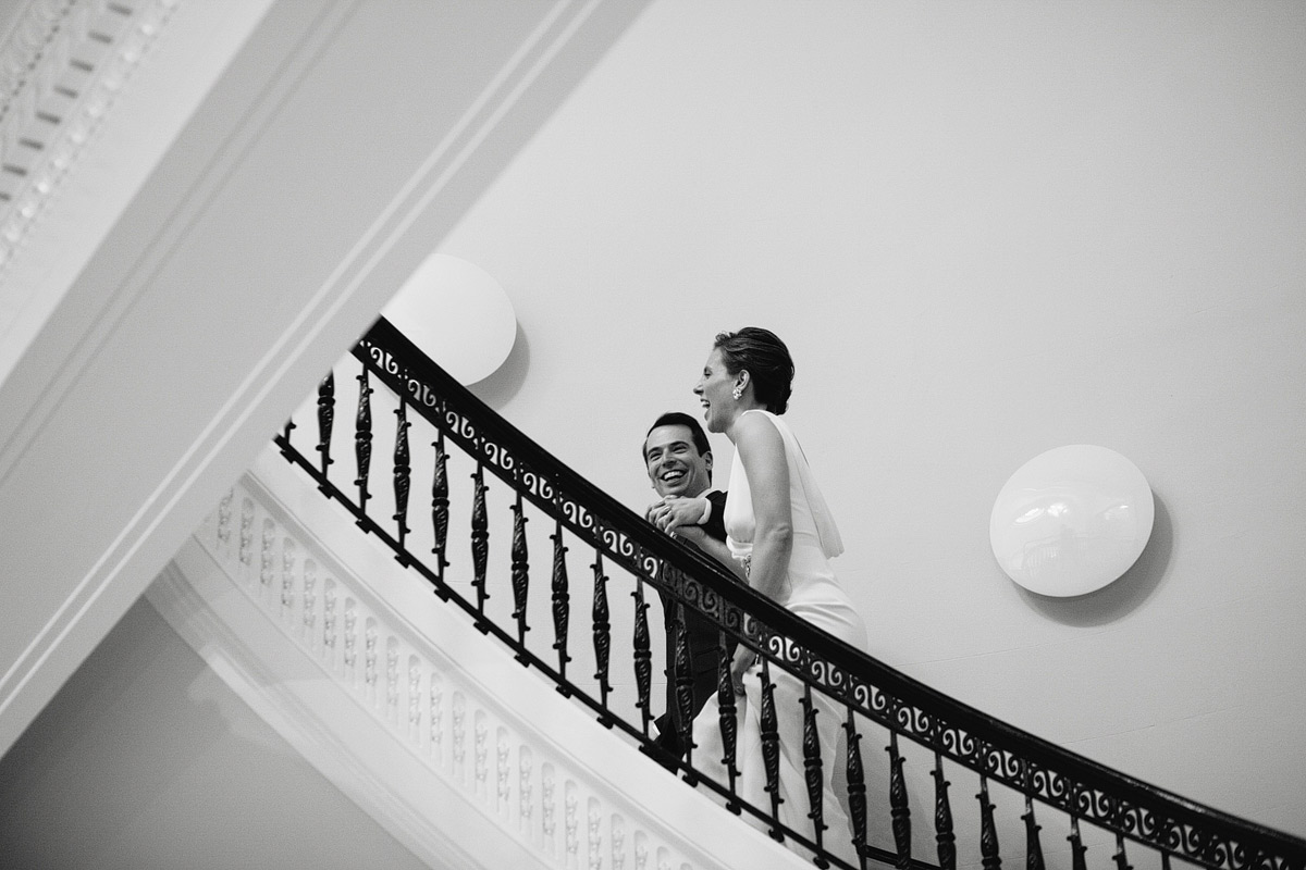 married couple walking up stairs at carnegie institute