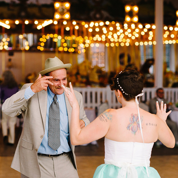 first dance in front of carousel at wedding in new haven