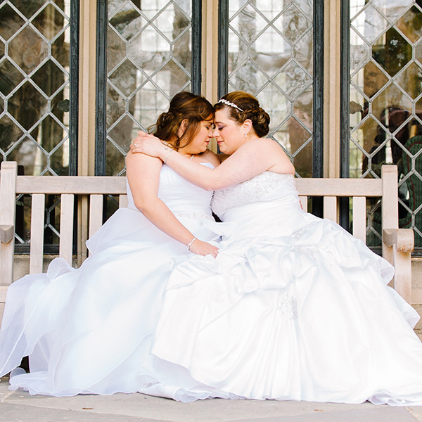 two brides holding each other